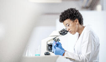 researcher using Lab tools